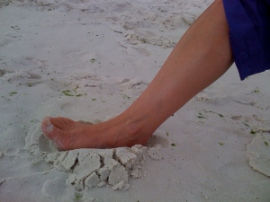 Foot rooting into the sand.